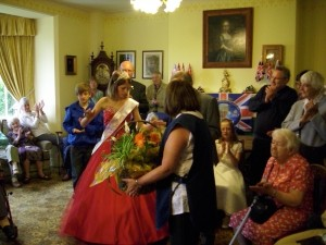 The Festival Queen presents Mrs Jones with a beautiful bouquet