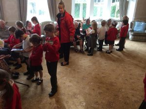 Olliverson's Primary School visiting Bushell House to read to the residents
