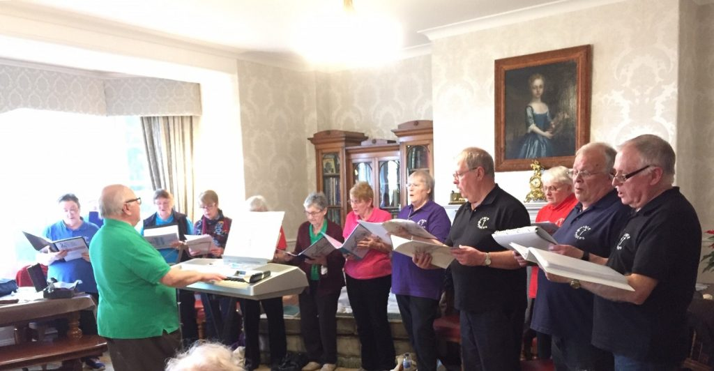 The Grace Notes Choir singing for the residents at Bushell House