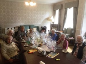 Residents making crafts for coffee morning