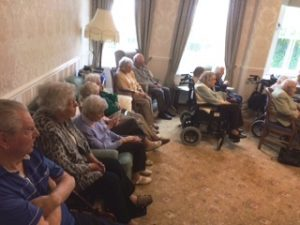 Lifelong singers performing at Bushell House